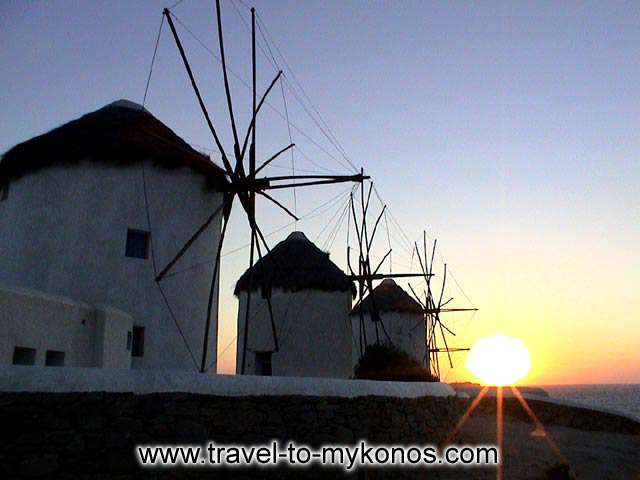 A terrific view of the sunset and the windmills.